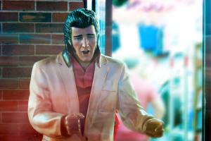 Sidewalk Elvis with Passing Pedestrians